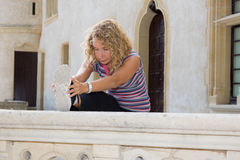 Blond woman doing stretching exercises in countryside Royalty Free Stock Image