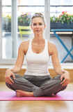 Blond woman doing yoga royalty free stock photos