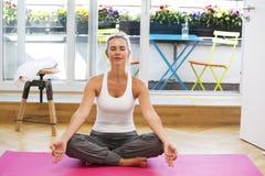 Blond woman doing yoga stock photos
