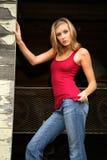 Blond Woman in doorway Stock Photo