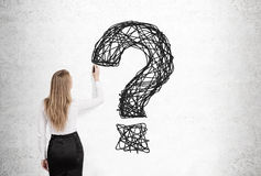 Blond woman drawing question mark Stock Photo