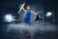 A blond woman in a dress in a studio Royalty Free Stock Photos