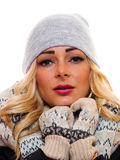Blond woman Dressed for winter. A attractive blond woman is dressed for winter on a white background stock image