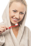 Blond Woman in Dressing Gown Cleaning Teeth with Manual Toothbru Royalty Free Stock Image