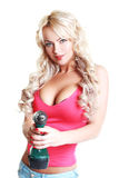 Blond woman with drill Royalty Free Stock Photography