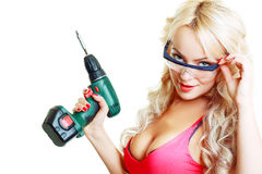 Blond woman with drill Royalty Free Stock Images