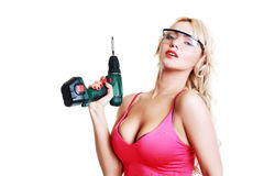 Blond woman with drill Stock Image