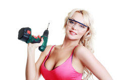 Blond woman with drill Royalty Free Stock Photos