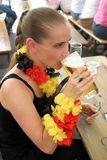 Blond woman drinking beer Royalty Free Stock Photos