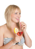 Blond woman drinking cocktail. Pretty young blond woman drinking red cocktail stock image