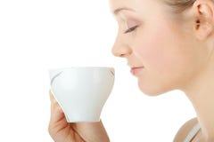 Blond woman drinking coffee Stock Image