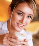 Blond woman drinking coffee in the morning at restaurant Stock Photo