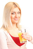 Blond woman drinking orange juice Royalty Free Stock Photography