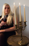 Blond woman drinking wine Royalty Free Stock Photography