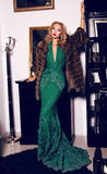 Blond woman in elegant dress and fur coat posing in luxurious interior. Fashion photo of gorgeous blond woman in elegant dress and fur coat posing in luxurious royalty free stock images