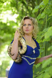 Blond woman in elegant dress with a python Royalty Free Stock Images