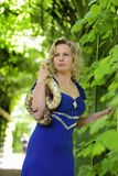 Blond woman in elegant dress with a python Royalty Free Stock Image
