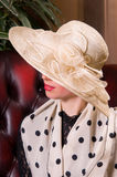 Blond woman in an elegant hat Royalty Free Stock Photo