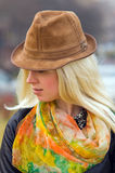 Blond woman in an elegant hat Royalty Free Stock Photography