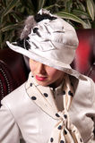 Blond woman in an elegant hat Royalty Free Stock Images