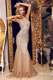 Blond woman in elegant sequin dress posing in luxurious interior Royalty Free Stock Photography