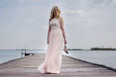 Blond woman in evening gown at lake Royalty Free Stock Photo