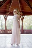 Blond woman in evening gown posing Royalty Free Stock Images