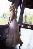 Blond woman in evening gown posing Royalty Free Stock Photography