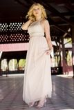 Blond woman in evening gown posing Stock Photography
