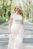 Blond woman in evening gown running Royalty Free Stock Image