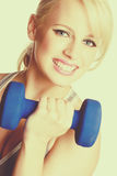 Blond Woman Exercising. Beautiful smiling blond woman exercising Royalty Free Stock Photos
