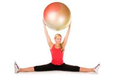 Blond woman exercising with a pilates ball. On the white background Royalty Free Stock Photos
