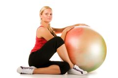 Blond woman exercising with a pilates ball. On the white background Royalty Free Stock Photography