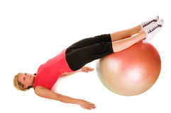 Blond woman exercising with a pilates ball. Over white background Stock Photo