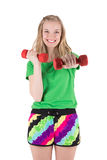 Blond woman exercising with red dumbbells. Royalty Free Stock Photos