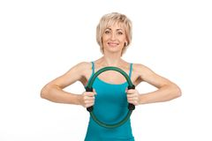 Blond woman exercising on white background. Aged lady front view waist up and smiling Royalty Free Stock Images