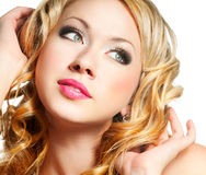 Blond woman face. Beautiful blond woman with curl hair Stock Photo