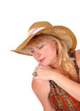 Blond woman with fashion hat. A portrait image of a pretty blond woman in a dress wearing a hat Stock Photo