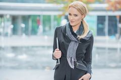 Blond Woman in Fashionable Black Office Attire Royalty Free Stock Image