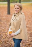 Blond Woman in Fashionable Brown Autumn Attire Royalty Free Stock Images