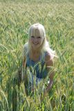 Blond woman in field Stock Photo