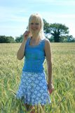 Blond woman in field Stock Images