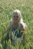 Blond woman in field Royalty Free Stock Photography