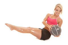 Blond woman fitness medicine ball sit twist Stock Photography