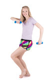 Blond woman in fitness wear exercising with the dumbbells on the white background. Young blond woman in fitness wear exercising with the blue dumbbells on white Stock Photos
