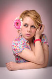 Blond woman with flower Royalty Free Stock Photography