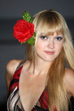Blond woman with flower in hair Stock Image