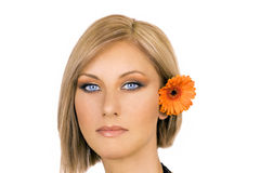 Blond woman with flower in hair Royalty Free Stock Photo