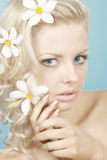 Blond woman with flowers Royalty Free Stock Photography