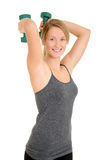 Blond woman with free weights Royalty Free Stock Image